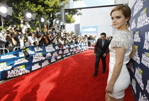 British actress Emma Watson and director JJ Abrams arrive at the 2011 MTV Movie Awards in Los Angeles